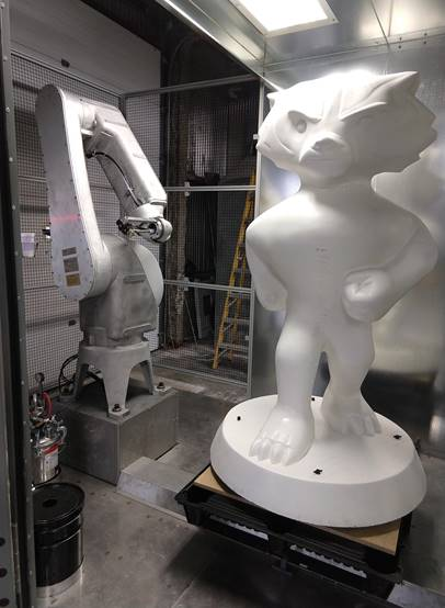 Bucky statues were painted with a white base coat by this FANUC robot