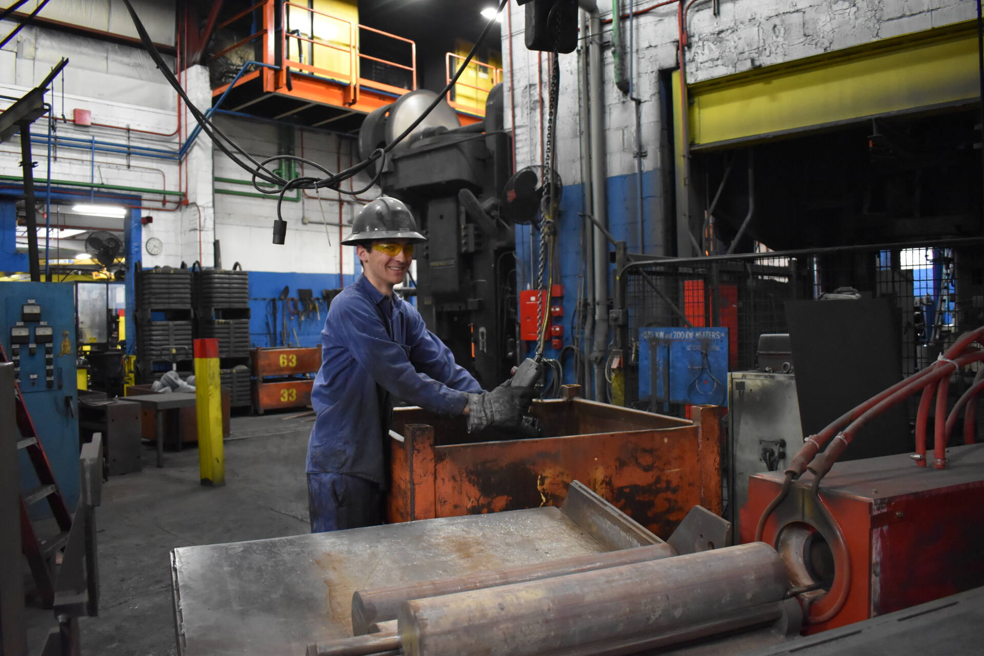 Noah, a student at the University of Wisconsin, works at Engel Tool and Forge on the manufacturing floor during winter break