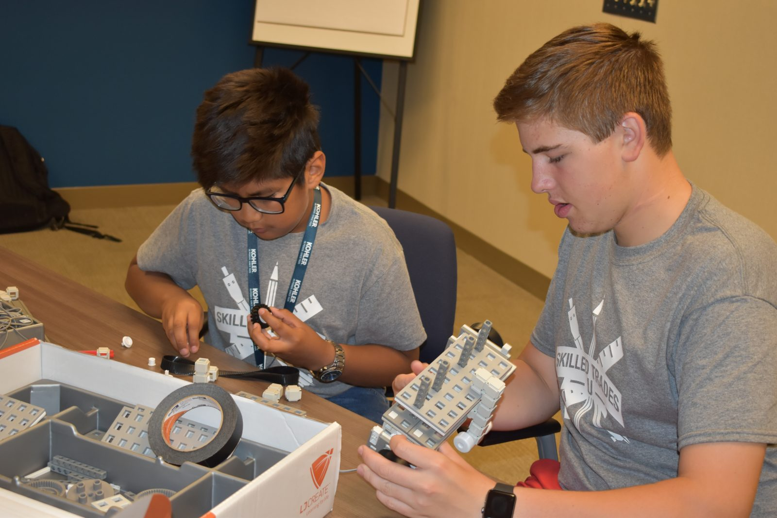 Students problem solve with their LJ Create vehicle at the Kohler Skilled Trades Camp