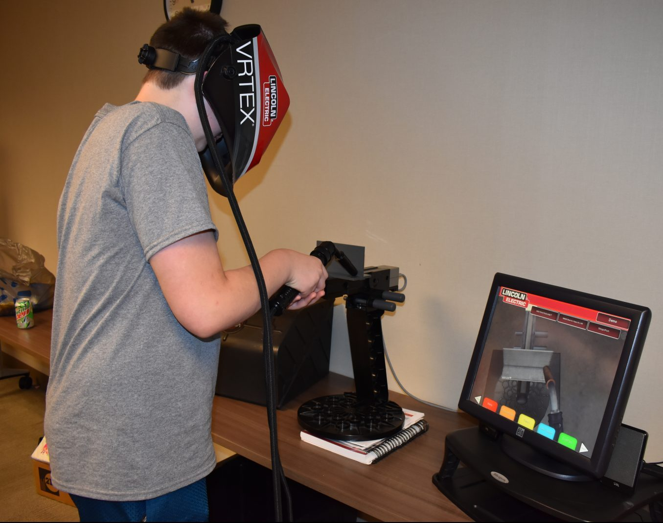 Student works with the Lincoln Electric Virtual Welder at the Kohler Skilled Trades Camp