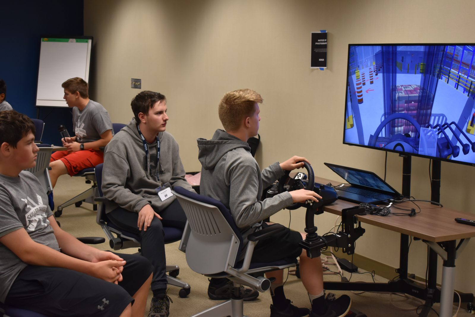 Students try out the Simlog forklift simulator at the Kohler Skilled Trades Camp
