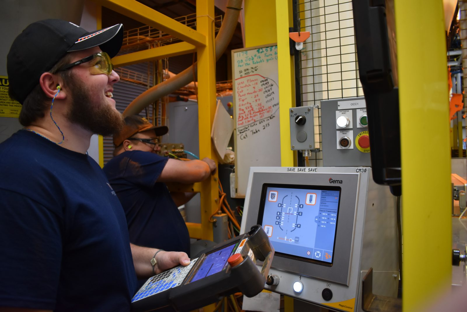 Kyle Pike, recent high school grad, works at Metalcraft of Mayville operating a FANUC paint robot