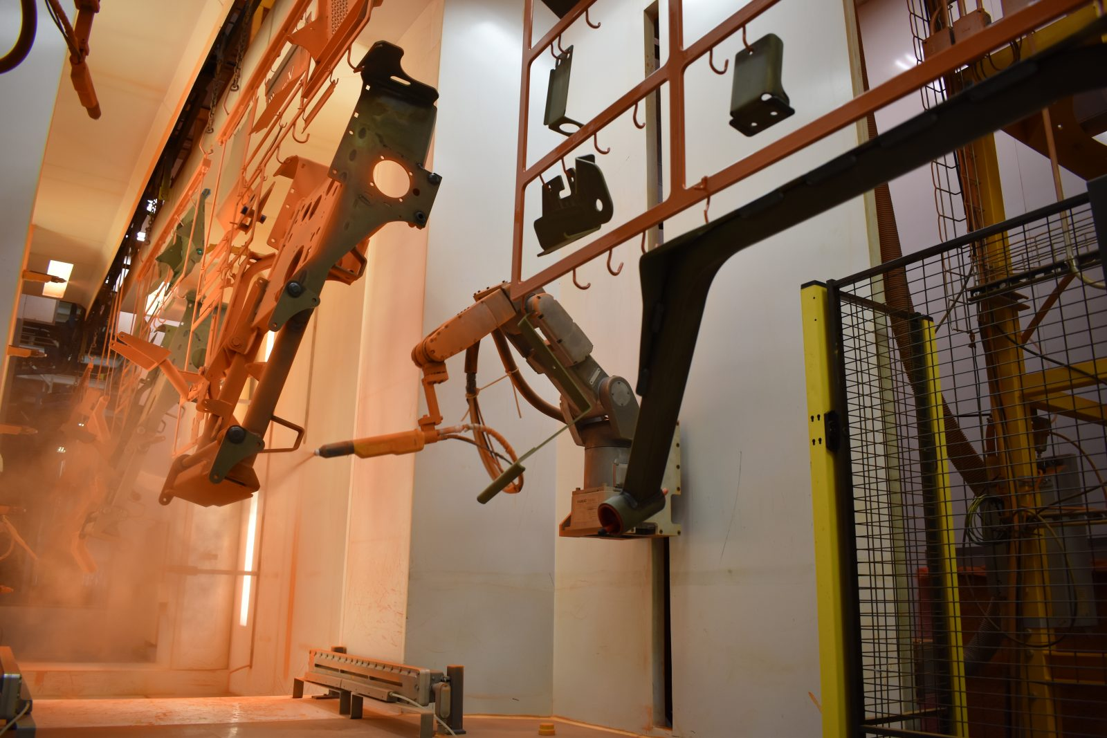 FANUC Robots paint Metalcraft Scag mowers, programmed by high school grad