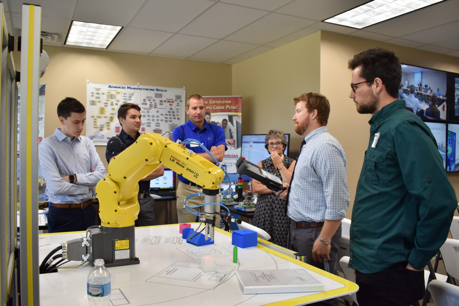 Milwaukee Intern Summit attendees get a look at FANUC educational robots at the LAB Midwest Tech Center