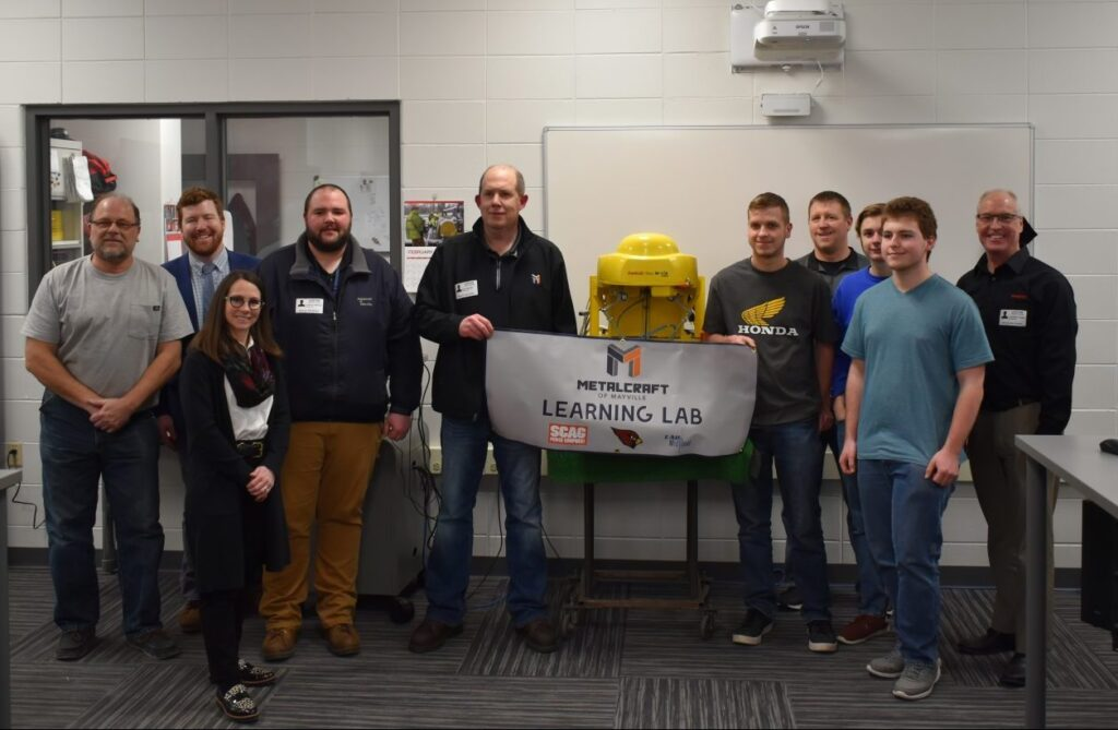 Mayville High School Team with LAB Midwest, FANUC and Metalcraft of Mayville at the awards presentation for the Team Robotics Competition