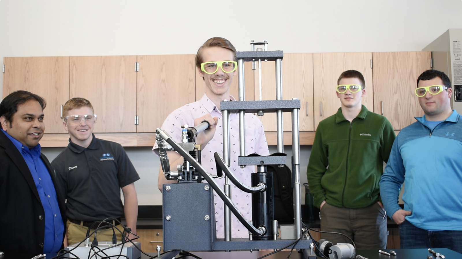 UW-Green Bay Engineering students use a TecQuipment tensile test strength experiment.